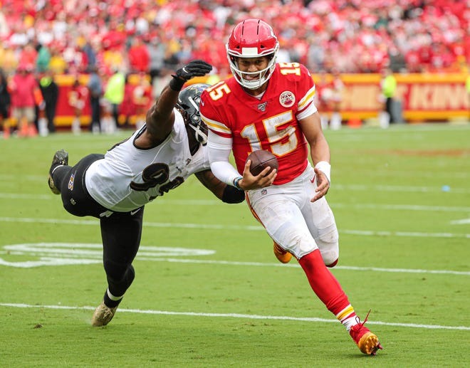 Kansas City Chiefs quarterback Patrick Mahomes eludes Baltimore Ravens linebacker Matt Judon (99) in last year's game at Arrowhead Stadium. Mahomes and the Chiefs travel to Baltimore Monday for a showdown of what many believe are the best two teams in the NFL.