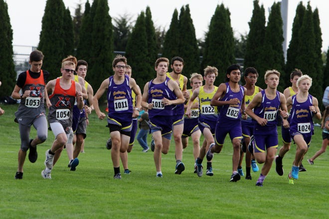 Runners take off at the start of the boys varsity race of the 17th annual Tony Proctor Cross Country Invitational, Thursday Sept. 24, 2020 at the Burlington Regional RecPlex