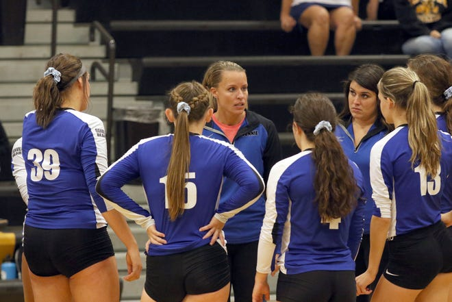 Danville head coach Amy West talks with her players during a timeout during a match against New London Sept. 22 in Charles Lorber Gymnasium.
