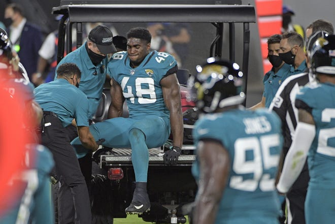 Jaguars' linebacker Leon Jacobs (48) is carted off the field after a first-half injury during Thursday's 31-13 loss to the Miami Dolphins. Jacobs, who was put on injured reserve and is out for the season, is one of several injured players that is now putting a dent on the team's depth chart. (AP Photo/Phelan M. Ebenhack)
