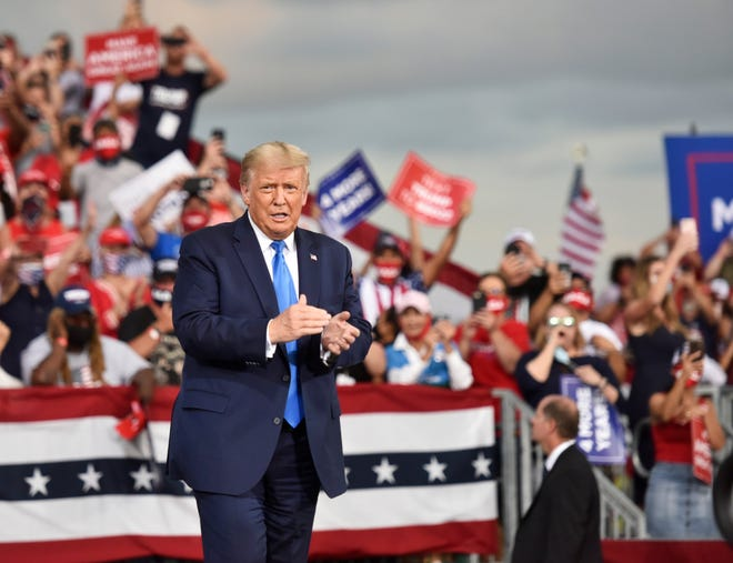 President Donald Trump takes the stage before an overflow crowd Thursday, September 24, 2020 at the Great American Comeback Event at the Cecil Commerce Center in Jacksonville, Florida. (Will Dickey/Florida Times-Union)