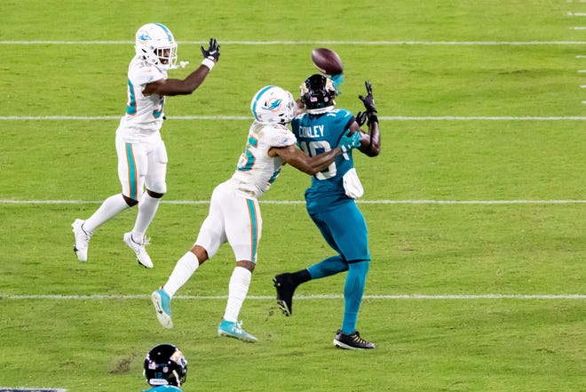 Jacksonville Jaguars wide receiver Chris Conley attempts to catch a pass against Dolphins cornerback Xavien Howard on Thursday night.