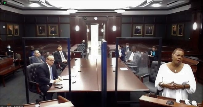 Sen. Audrey Gibson (right) joins Duval County Judge Gary Flower (left) and others Friday at the first meeting of the Elder Abuse Fatality Review Team in Courtroom 406 at the Duval County Courthouse. Many members met via Zoom.