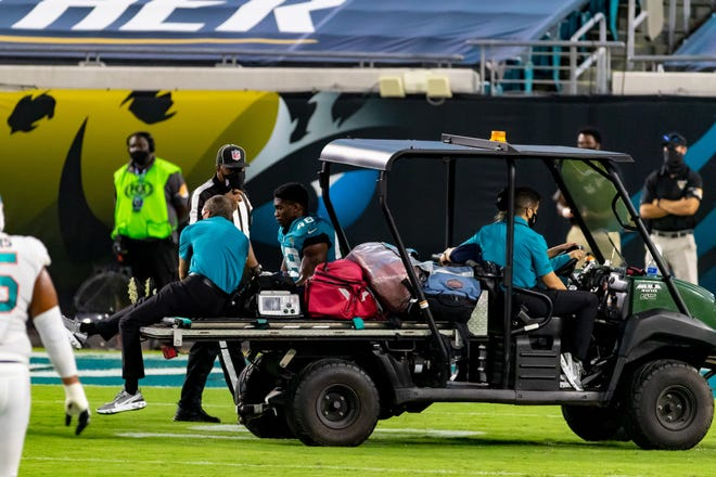 Jaguars linebacker Leon Jacobs (48) is taken off the field on a medical cart after injuring his knee during Thursday's game against the Miami Dolphins at TIAA Bank Field. Matt Pendleton/For the Times-Union