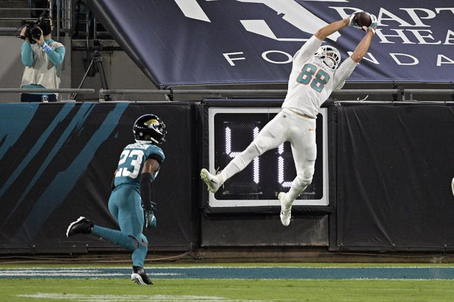 If the Jaguars hope to fix their defense, they can't have plays like this from Thursday night where Miami Dolphins tight end Mike Gesicki snares a touchdown pass over onlooking cornerback CJ Henderson in a 31-13 Dolphins' victory. (AP Photo/Phelan M. Ebenhack)