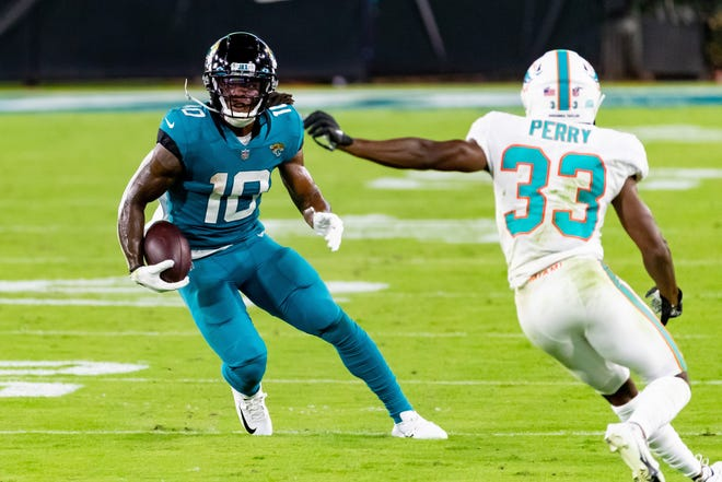 Jaguars wide receiver Laviska Shenault Jr. (10) breaks away from Miami Dolphins cornerback Jamal Perry (33) during Thursday's game at TIAA Bank Field. Matt Pendleton/For the Times-Union