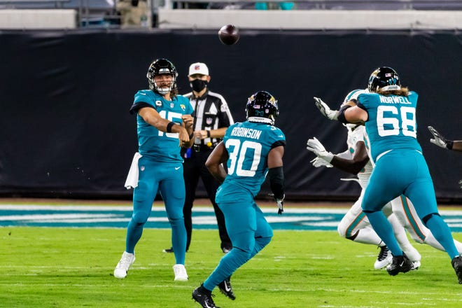 Jacksonville Jaguars quarterback Gardner Minshew (15) throws a pass to Jacksonville Jaguars running back James Robinson (30) during the Jacksonville Jaguars vs. Miami Dolphins game on NFL Thursday Night Football at TIAA Bank Field in Jacksonville, FL on Thursday, September 24, 2020.