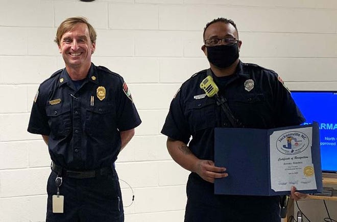 Jacksonville Fire and Emergency Services Firefighter Jeremy Jimenez recently celebrated five years of dedicated service with the department. He is pictured with Fire Chief Edward Tallman.