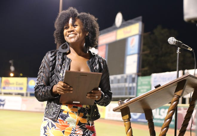Sassy's Fitness owner Takeema Parson smiles after winning Minority Business of the Year during the Kinston-Lenoir County Chamber of Commerce's Small Business Awards Thursday, Sept. 24 at Grainger Stadium's Mother Earth Pavilion. [Brandon Davis/Kinston Free Press]
