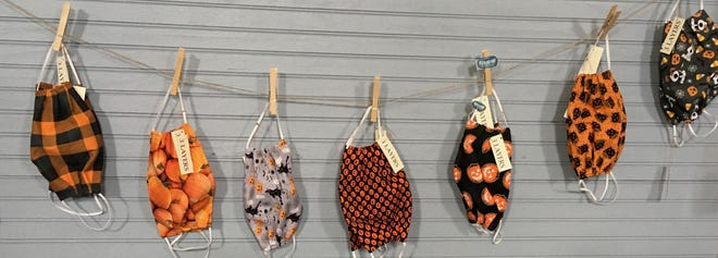 Fall and Halloween-themed masks are on sale in the Friends Shop at the Twinsburg Public Library.