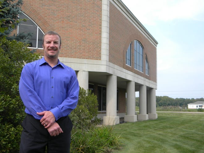 Jason Chadock, standing outside the Macedonia Family Recreation Center, started his new job as the city's parks and recreation director on Aug. 3.