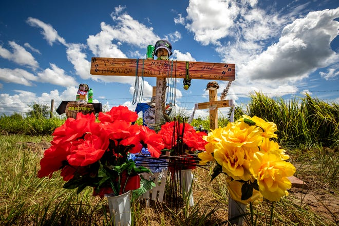 A roadside memorial for Brandon Rollins, Damion Tillman and Keven Springfield is located on Lake Streety Road in Frostproof where the three friends were shot to death on July 19.