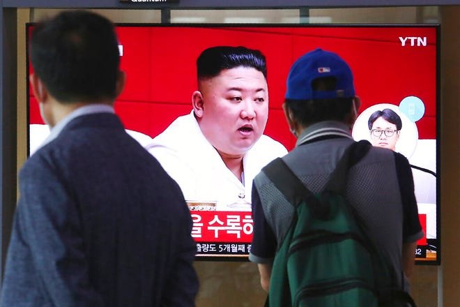"""People watch a screen showing a file image of North Korean leader Kim Jong Un during a news program at the Seoul Railway Station in Seoul, South Korea, Friday. Kim apologized Friday over the killing of a South Korea official near the rivals' disputed sea boundary, saying he's """"very sorry"""" about the """"unexpected"""" and """"unfortunate"""" incident, South Korean officials said Friday."""