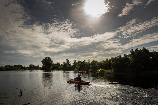 Kayakers paddle along a marked paddle trail that opened in 2018 in Tenoroc Wildlife Management area in Lakeland. The park was closed earlier this week because the main entry road was washed out by rains. It reopened Friday morning.