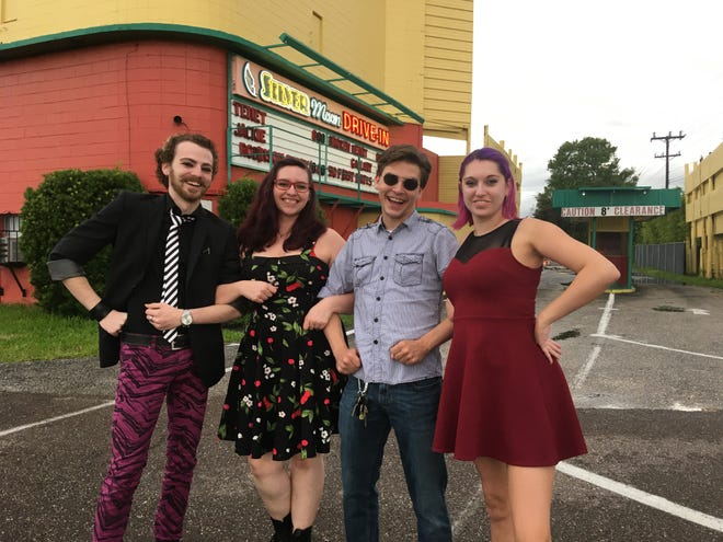 """Hell On Heels actors Calvin Mynatt, left, ''The Rocky Horror Picture Show's'' assistant director who plays """"Frankenfurter"""" in the play, stands with Grace Smithwick of Tampa (secretary and """"Magenta""""); Sam Burke (director and """"Riff Raff""""); and Susan Belliveau (producer and """"Janet"""") outside of Silver Moon Drive-In in Lakeland."""