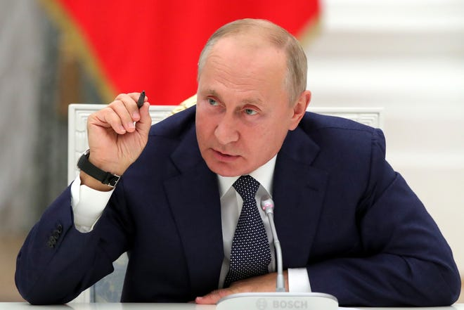 Russian President Vladimir Putin gestures while speaking during a meeting with employees of the nuclear industry on their professional holiday, Nuclear Industry Worker's Day, at the Kremlin in Moscow on Wednesday.