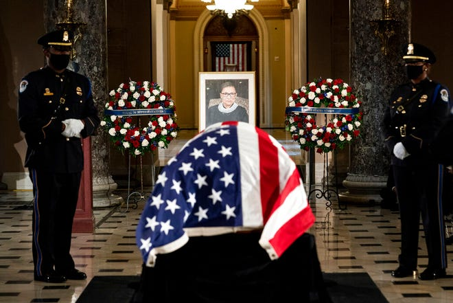 The flag-draped casket of Justice Ruth Bader Ginsburg lies in state in the U.S. Capitol on Friday, Sept. 25, 2020. Ginsburg died at the age of 87 on Sept. 18 and is the first women to lie in state at the Capitol.