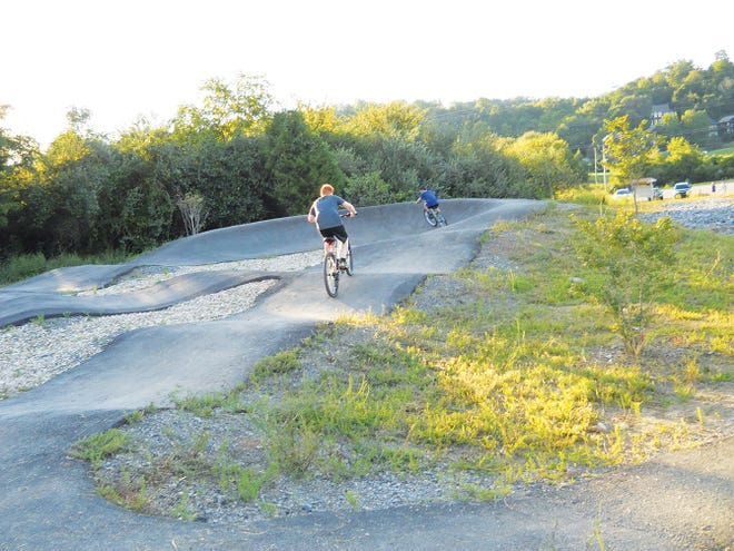 Young cyclists ride around the paved pumptrack. The area is just part of the larger Dirtlab, which includes various places to practice mountain bike skills. The grand opening and ribbon cutting for Dirtlab was scheduled for Sept. 25, but postponed to Oct. 9 because of the rainy weather.