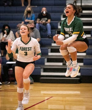 Forest's Madilyn Jerald and Emma Santi celebrate their win in the second set. Forest defeated Vanguard in three straight sets 25-22, 25-15 and 25-9 Thursday night.