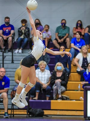 St. John's Rylee Palmateer hits a ball during Thursday's match at Meadowbrook Academy. The Saints won in three sets 25-21, 25-24, 25-15.