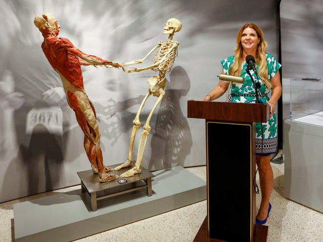"""Kate Arrizza, CEO of the South Florida Science Center and Aquarium, talks about """"Real Bodies: The Exhibition"""" at the center Thursday. [PHOTOS BY DAMON HIGGINS/PALMBEACHPOST.COM]"""