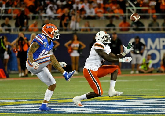 Miami safety Amari Carter (5) intercepts a pass during last season's game against the Florida Gators.