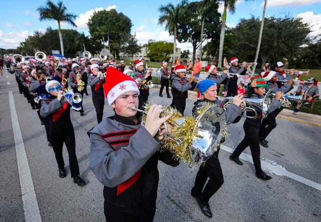 The Palm Beach Central High School Broncos Band performs during the 36th Annual Wellington Holiday Parade in December. This year's Wellington Holiday Parade has been postponed because of the novel coronavirus pandemic.
