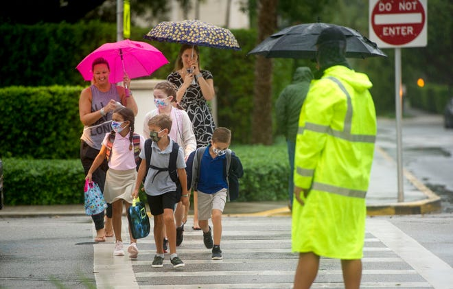 Students arrive for the first day of on-campus learning at Palm Beach Public Elementary School on Sept. 21.
