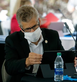 Del. Kirk Cox, R-Colonial Heights, sets up his computer during the veto session at the Virginia State Capitol in Richmond, VA Wednesday, April 22, 2020. The House members were meeting outside in a tent instead of the House Chamber in order to practice social distancing due to the COVID-19 virus.