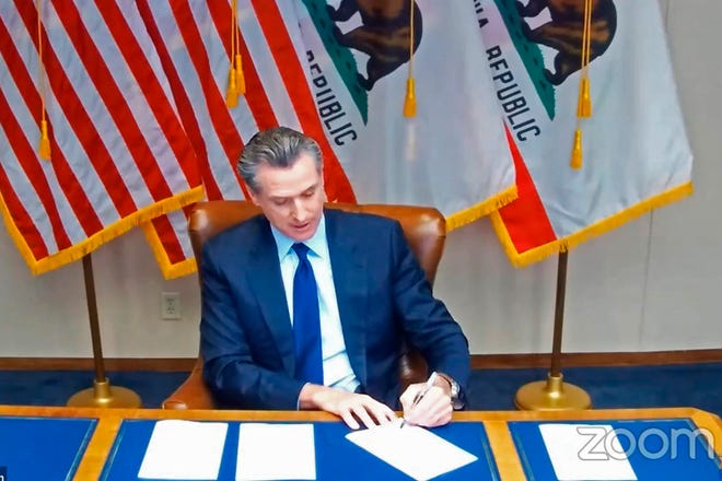 """Gov. Gavin Newsom signs a law on Friday that for the first time defines """"medical necessity,"""" a move aimed at requiring private health insurance plans to pay for more mental health and drug addiction treatments. """"I got a lot of folks that wanted to pull the plug on this Zoom call today, but we're doing it because we're zooming into the future,"""" Newsom said."""