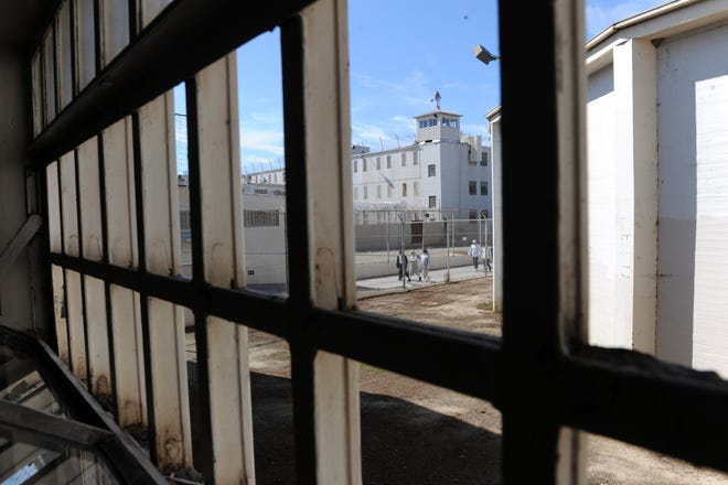 Inmates come in from the yard at Deuel Vocational Institution in Tracy in 2012. The state announced a plan Friday to shut Deuel, which  which employs 1,080 workers and houses approximately 1,500 inmates, within a year.