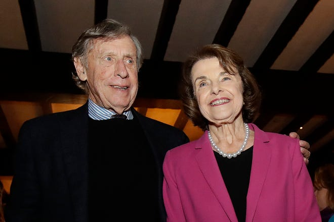 Richard Blum, left, seen with wife Sen. Dianne Feinstein in 2018, was named Thursday by the state auditor's office as one of the regents involved in admissions scandal where UC wrongly admitted dozens of wealthy, mostly white students as favors to well-connected people.