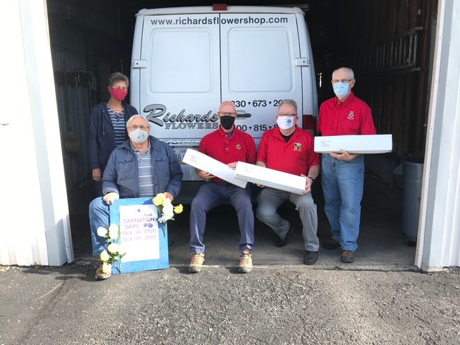 The Kent Lions Club has decided to cancel its Carnation Days fundraiser this year. From left are Lions and Carnation committee members Jane Gwinn, Jerry Fiala, Jeff Coffee, Tony DeLuke and Jim Stroble.