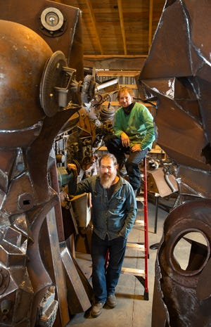 """Joe Mross, bottom, and Jeff Shauger collaborated on a giant multi-piece sculpture called """"Drossian Resource Ark Glenwood Object 19,"""" featuring hundreds of pieces from of our industrial past."""