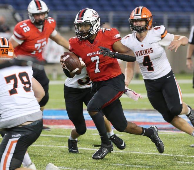 Hoover's Drew Logan (4) — pursuing McKinley QB Elijah Wesley during their game Sept. 4, 2020 — is receiving plenty of college interest. (CantonRep.com / Scott Heckel)