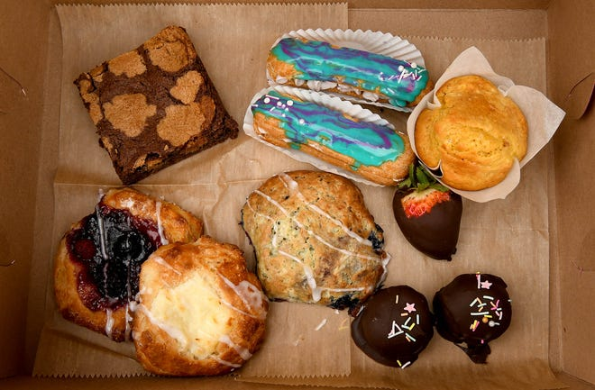 Little Flour Baking Co. owner Heather Reamy makes trays of baked goods, like this boxed assortment, daily for curbside pickup in the alley behind Ohio Deli in Canton. Single items can be purchased.