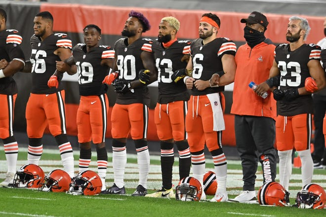 """Sep 17, 2020; Cleveland, Ohio, USA; Members of the Cleveland Browns stand arm in arm as """"Lift Every Voice and Sing"""" is played before the game between the Cleveland Browns and the Cincinnati Bengals at FirstEnergy Stadium. Mandatory Credit: Ken Blaze-USA TODAY Sports"""