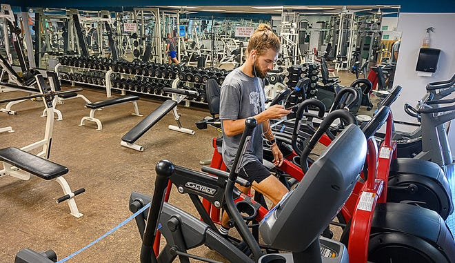 Josh Morton works out at Anastasia Fitness in St. Augustine on Friday.