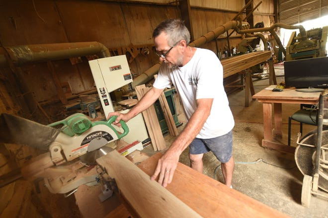 Chris Metz in the workshop at Old Growth Riverwood. They recover and process reclaimed wood into flooring, counter tops, molding, trim, mantles, and furniture Aug. 12, 2020. [KEN BLEVINS/STARNEWS]
