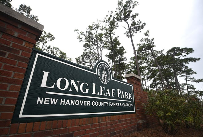 On Wednesday morning permanent signs were installed at Long Leaf Park by the New Hanover County Parks Department.  They replaced the temporary signs that were put up on July 14 after the New Hanover Board of Commissioners voted the previous night to change the name of county-owned Hugh MacRae Park to Long Leaf Park.