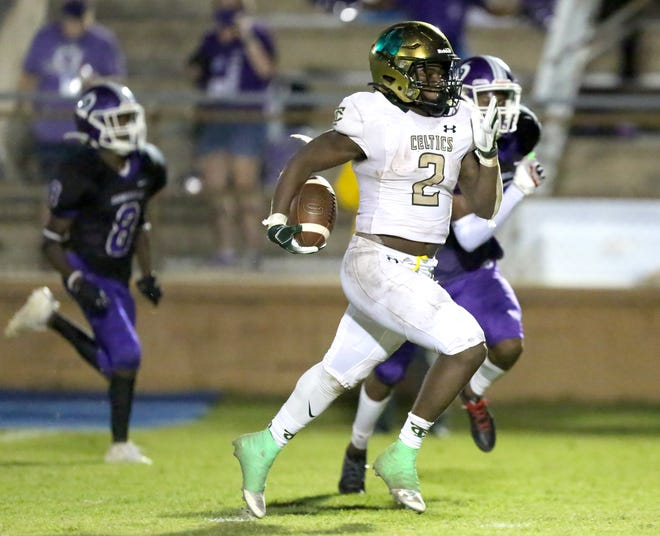 Ocala Trinity Catholic running back Jamarian Samuel breaks a long run Thursday against Gainesville High at Citizens Field in Gainesville. The Celtics beat the Hurricanes 38-7.
