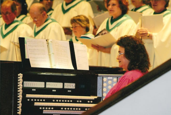 Gloria Johnson, at the organ, at Southside Baptist Church, where she's been a part of the music ministry for 60 years. Johnson is retiring as organist this month.