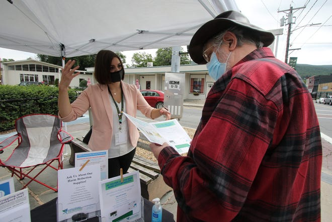 Health worker Shannon North speaks to James Baker of Ellenville recently during the outreach initiative.