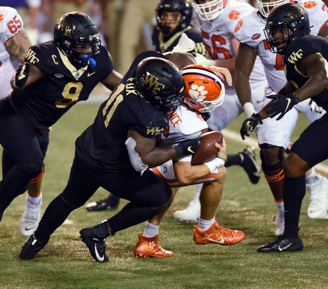 Wake Forest defensive lineman Miles Fox sacks Clemson quarterback Trevor Lawrence.