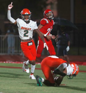 Mosley's Chris Culver (2) celebrates a touchdown by teammate Trey Johnson (4). Bay faced off with Mosley for a football game on Sept. 24, 2020 at Tommy Oliver Stadium.