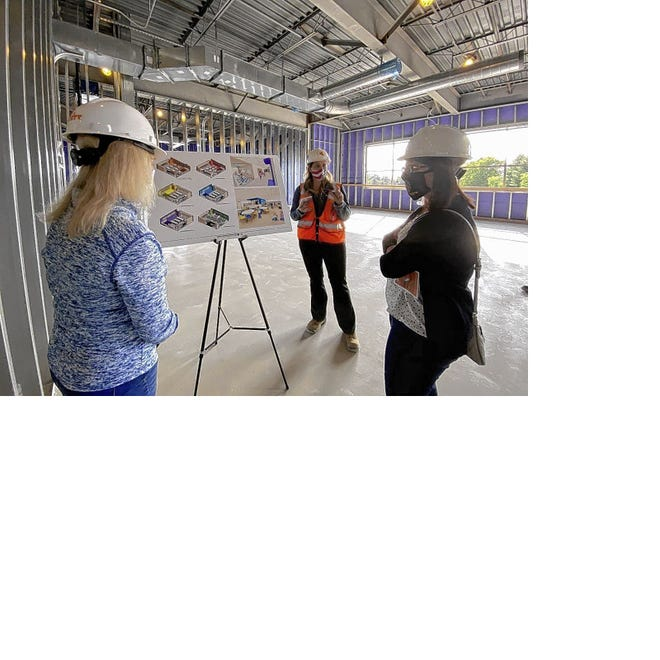 Jamie Srbljan (center), project manager for Corna Kokosing Construction Co., explains the layout and progress of the new Lincoln Elementary School to Gahanna-Jefferson Public School board member Daphne Moehring (far left) and board president Beryl Brown Piccolantonio during a Sept. 21 tour. They are standing in what will be a fifth-grade classroom at the school.