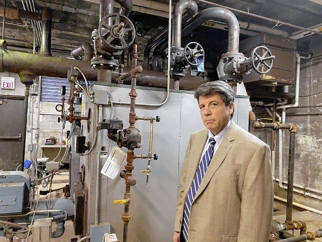 Steve Barrett, Gahanna-Jefferson Public Schools superintendent, stands in a boiler room in one of the older sections of Lincoln High School. Part of the proposed Issue 22 would replace the high school.
