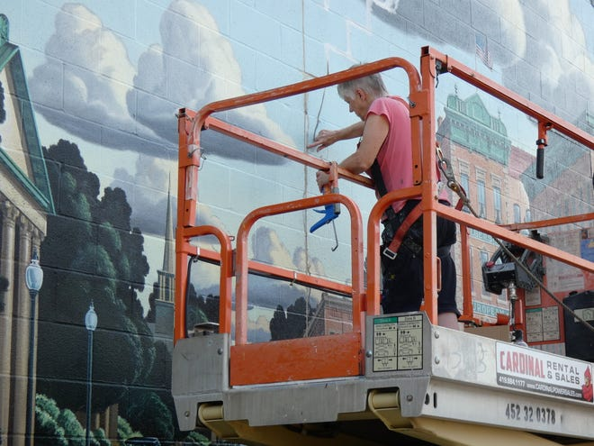 Artist Mo Taylor of Galion estimates it will take three or four weeks— if the weather cooperates — to repair the damage to the Great American Crossroads mural.