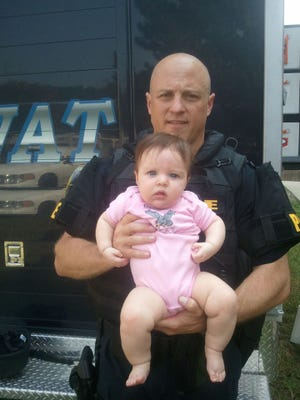 Officer Mike Bell with his daughter.