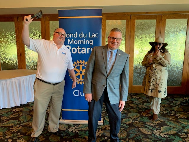 Fond du Lac Morning Rotary prepares for it's 27th annual Wine around the World with a murder mystery show by Laughable Productions. Pictured from left is: Brian Johnson, Morning Rotary member and event committee member, Dan Nielson, Fond du Lac Morning Rotary president, Tracy Froh, Rotary member and event chair.